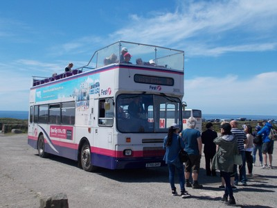 OPEN TOP TOUR BUS AT LANDS END ENGLAND.