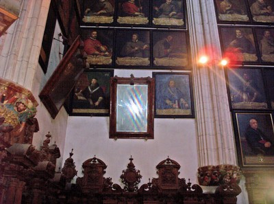 SPAIN  BURGOS.   Cathedral.  Among the portraits was a mirror.  My reflection was in the mirror, but the flash blanked me out.