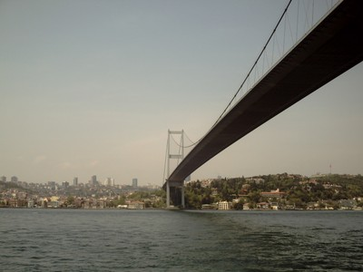 ISTANBUL  TURKEY.    Sailing under the bridge.
