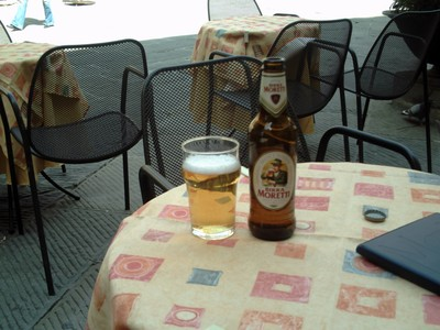 CORTONA, ITALY.   Enjoying a  beer  in  Piazza della  Republica.