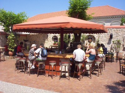GREECE  RHODES.   Bar for free drink in garden of clock tower,  .[ I had a beer