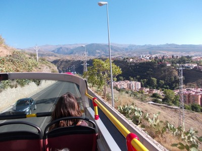 SPAIN  MALAGA.. On open top bus, on the outside of town,