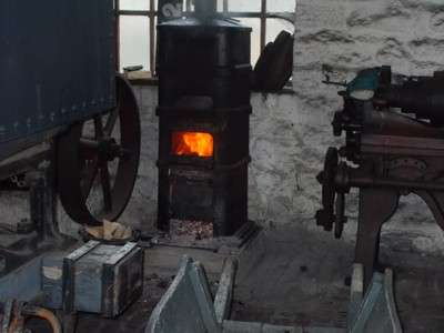 BEAMISH MUSEUM.  In the Engine Shed,a man was working here.