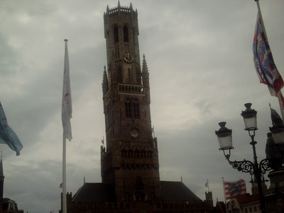 BRUGES  BELGUIM..    Belfrey Tower.    A medieval Bell Tower.  Narrow steep steps to top.   366 steps.    Tower 83m  [272ft }  high.   Building leans 87 centimetres to the East.
