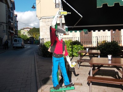 LLANES,  SPAIN.  --  I had  a Cider  in this Bar,  the  barman  served it  like  this  cutout .