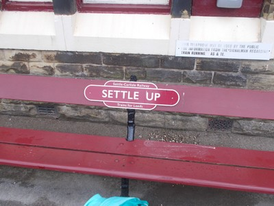 Settle  rail  station.    --   Who  with  ?