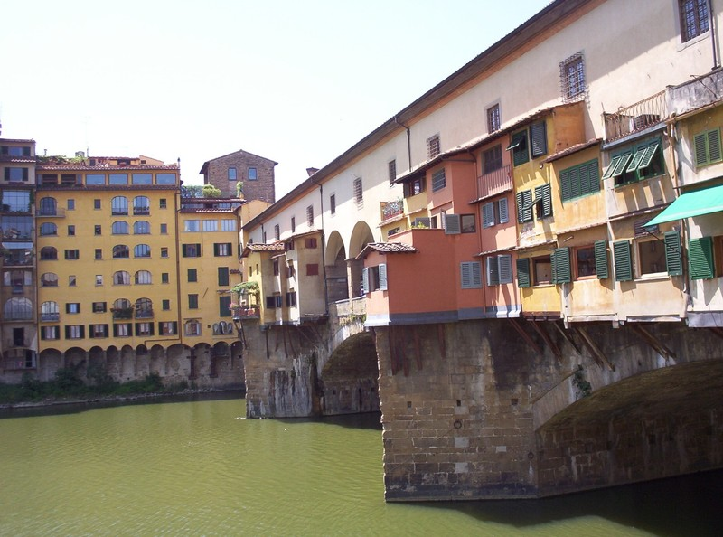 HISTORIC FLORENCE  ITALY. ---  Ponte  Vecchio  over  the  river  Arno.  The  shops  appear  to  be  clinging  on.