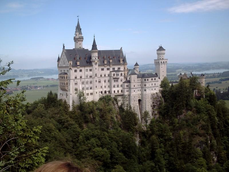SCHLOSS NEUSCHWANSTIEN  GERMANY.  --Ludwig's  castle high  in  the  trees  near  Fussen.