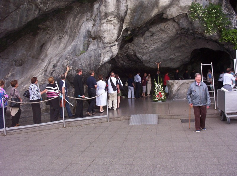 FRANCE  LOURDES.     Entering the Cave /Grotto.   It is said Bernadette saw the apparition here.in1858.