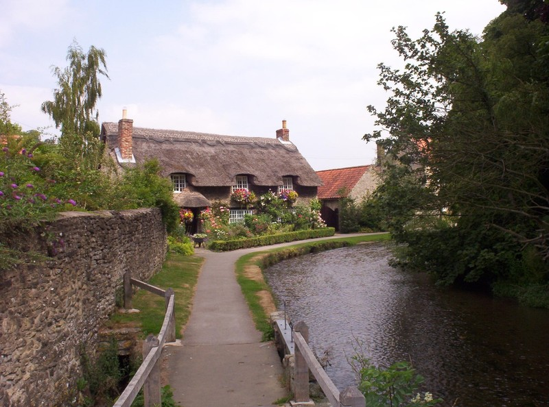 THORNTON-LE-DALE,  YORKSHIRE  UK. -- Thatched cottages built in the 17th  century.  -- Thornton Beck is  shallow.  Earlier some  children had been  paddling