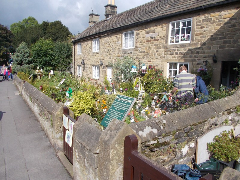 EYAM  Plague cottage.. The green notice gives names of those that died in this house.