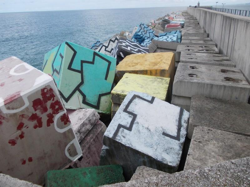 """LLANES,  SPAIN.--Breakwater  """" Cubes  of  Memory"""",  created  by Augustin Lbarrola."""