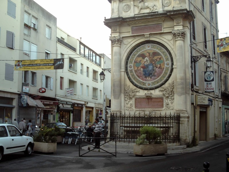 ARLES,  FRANCE.  -- Bar  Fontane,  Well and  fountain.--  Large  medallion of Paul Balze.  --  Lion of  Arles in  stonework  at  top.