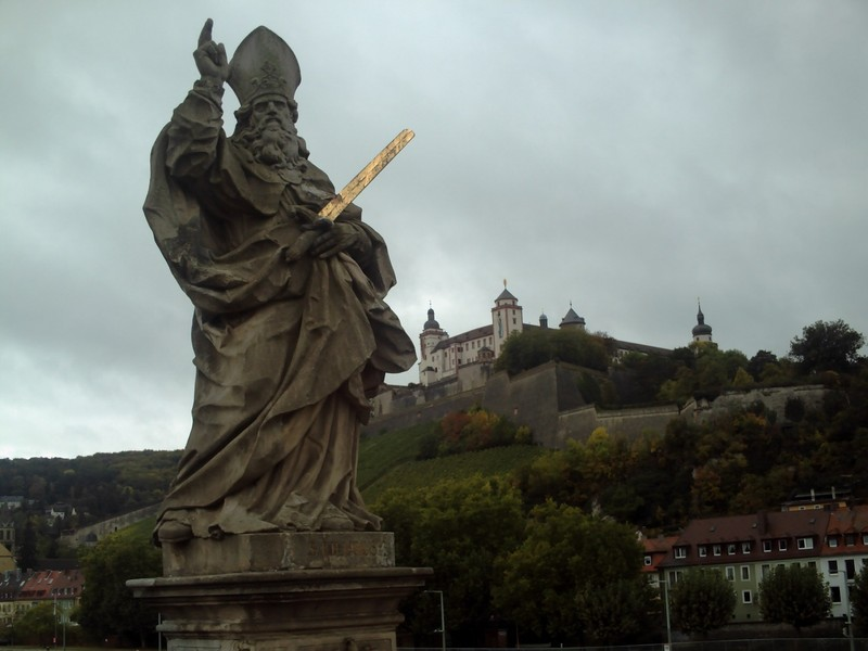 WURZBURG  GERMANY..    Statue of St. Kilian.    St Kilian is from the 7th century.  His Feast Day is 8th July...The Marienberg castle in the background.