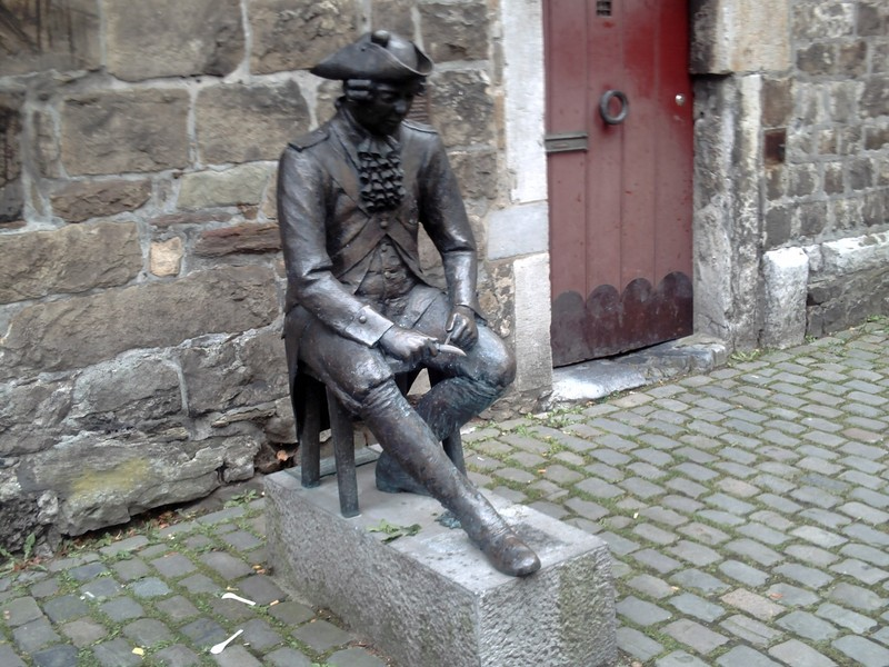 AACHEN  GERMANY.  Bronze statue of the Penn soldier, carving a piece of wood.