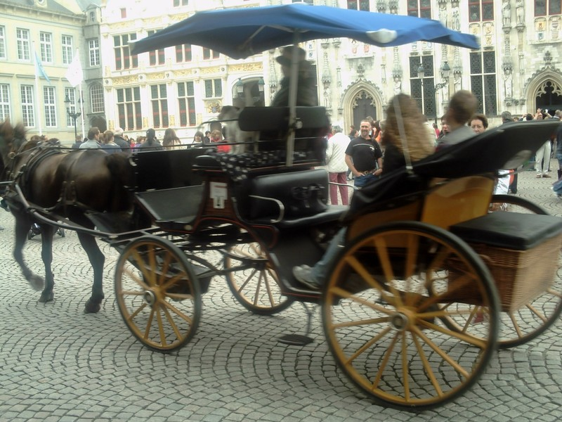 BRUGES BELGUIM.    Horse and Carriage, a good way to see Bruges, but not cheap.