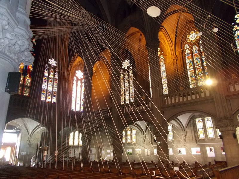 FRANCE  MULHOUSE.  Display by cables inside St Etienne Cathedral.