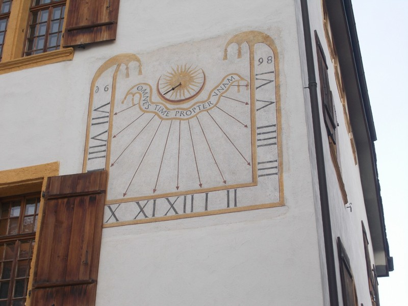 VISP  SWITZERLAND..   Sundial on wall of Town Hall.---Visp claims 300 days of sunshine a year.