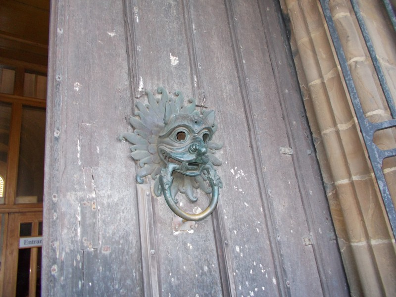 By knocking on this door.fugitives could claim sanctuary in the Middle Ages.