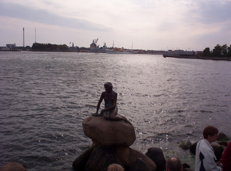 COPENHAGEN  DENMARK .     Based on a fairy tale by Danish author  Hans Christian Anderson, is the bronze statue of the Little  Mermaid , on a rock at Langeline Promenade