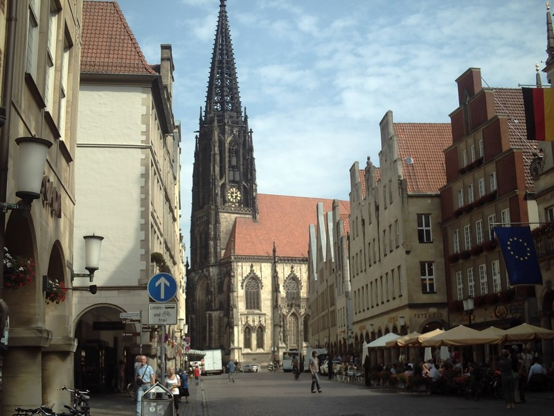 MUNSTER,  GERMANY. --   St, Lamberts Church.  Above the clock  face can just be seen, 3cages,that held the bodies of the leaders of the Anababist Movement Rebellion in