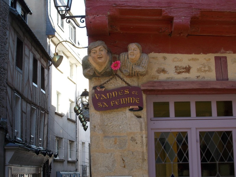 VANNES,  FRANCE.----Mr & Mrs  Vannes. carving on a corner in Place Valencia.