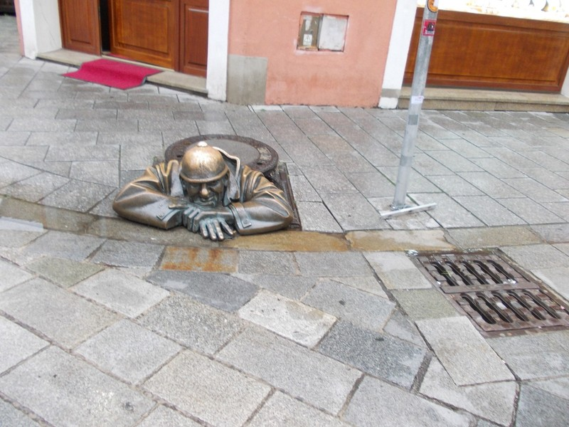 "BRATISLAVA...Sculpture, called ""Working Man""   [ in a drain."