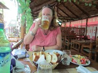 Angela enjoying a very cold beer in the resteraunt in Osh