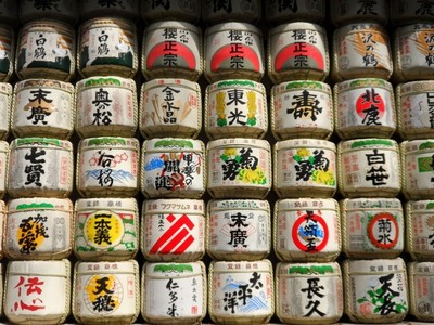 Beautifully decorated sake barrels.