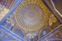 Tilla Kari Maddrasah, completed in 1660, is famous for its golden interior in its mosque. Looking up at the ceiling painted to look like a dome.