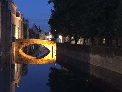Bridge at night with reflection in canal