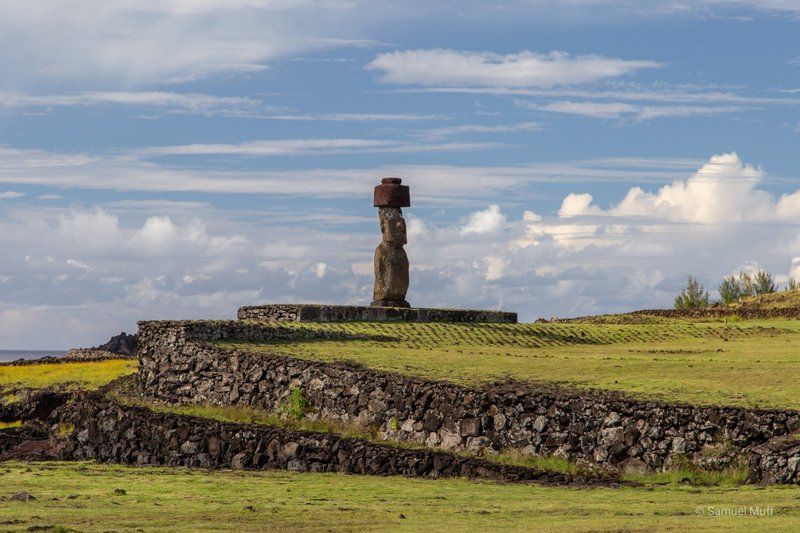 Moai with red hat and painted eyeballs