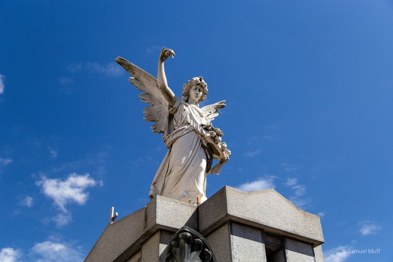 Statue on top of a mausoleum in the Recoleta cemetery