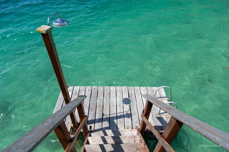 Stairs to the water from our overwater villa in Huahine