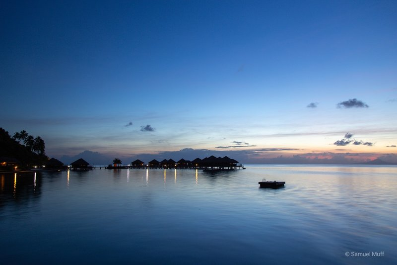 Overwater villas at Sunset in Huahine