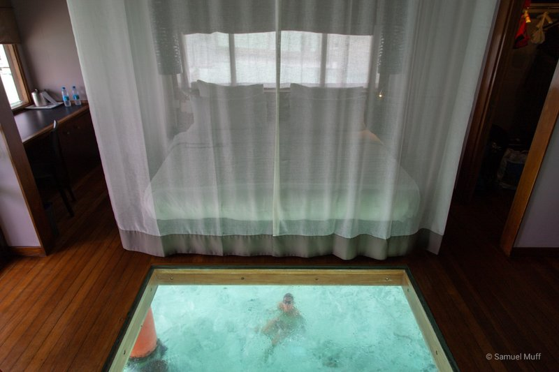 Inside of our overwater villa in Bora Bora, with Marta visible through the glass floor