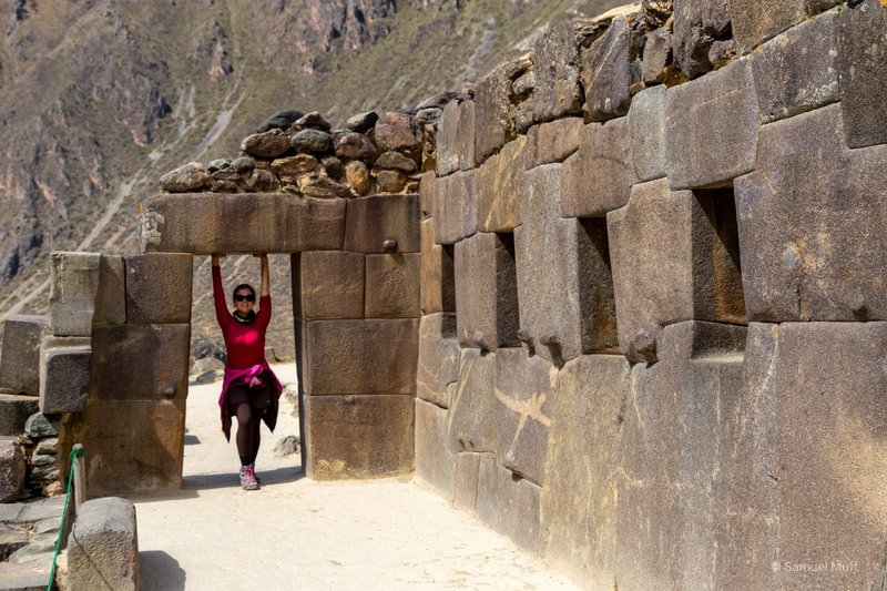 Marta standing in a door at the Ollantaytambo ruins