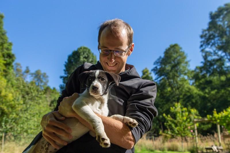 Sam with a husky puppy
