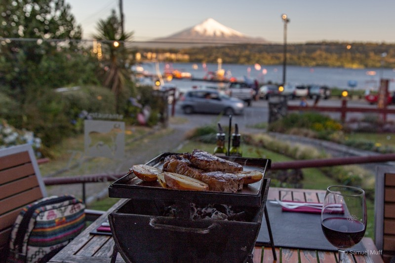 Asado and wine, with Volcán Villarrica (2861m) in the background