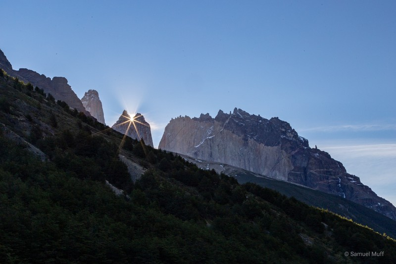 Sun setting behind Torre Norte, seen from Refugio Chileno