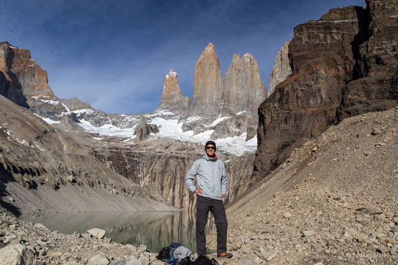 Sam in front of the Torres del Paine peaks and Lago Torres