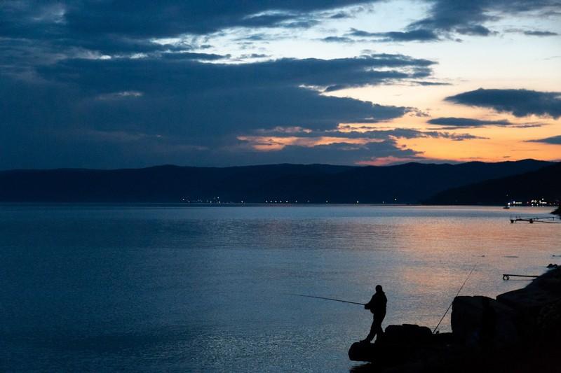 Fisherman at Lake Baikal in the evening