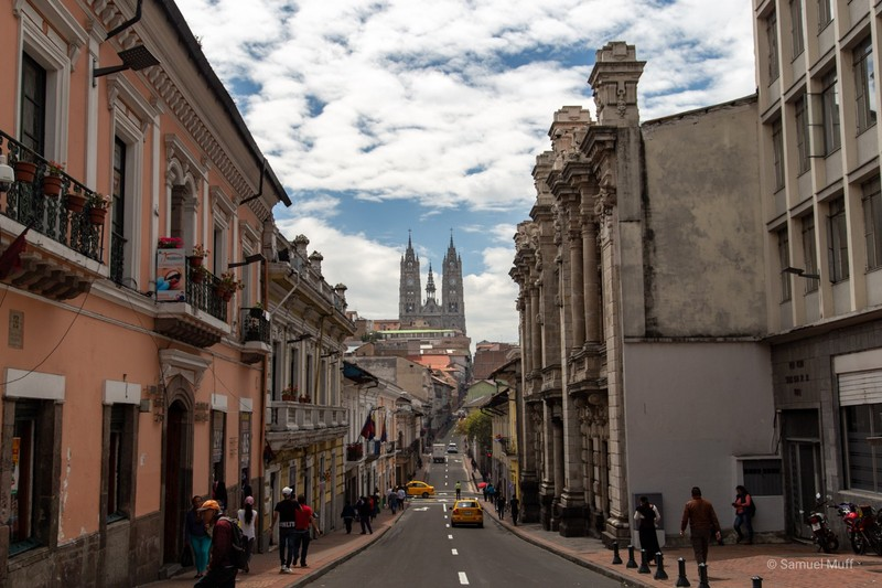 Street in the center of Quito with the Basílica del Voto Nacional in the distance