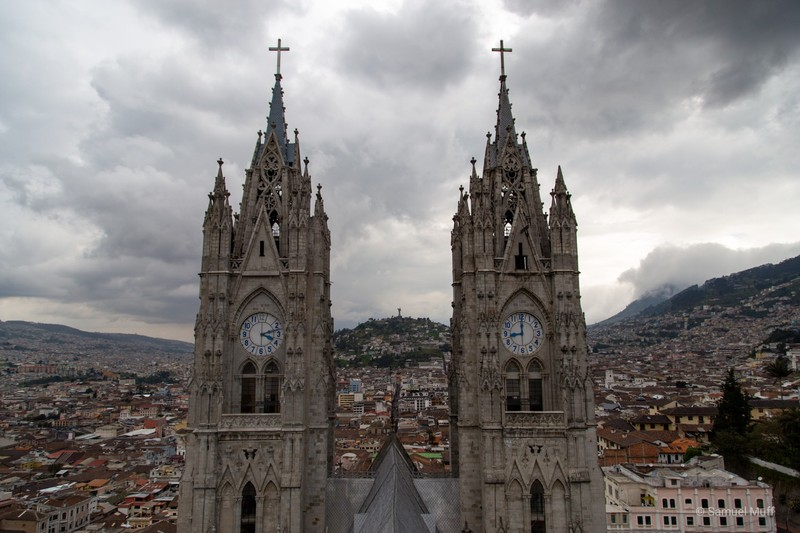 Quito seen through the two main towers of the Basílica del Voto Nacional