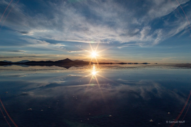 Sunset reflecting in the wet Salar de Uyuni