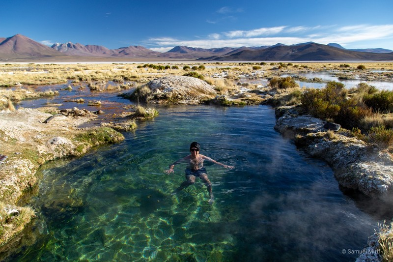 Sam in a natural hot pool in the middle of the Bolivian altiplano