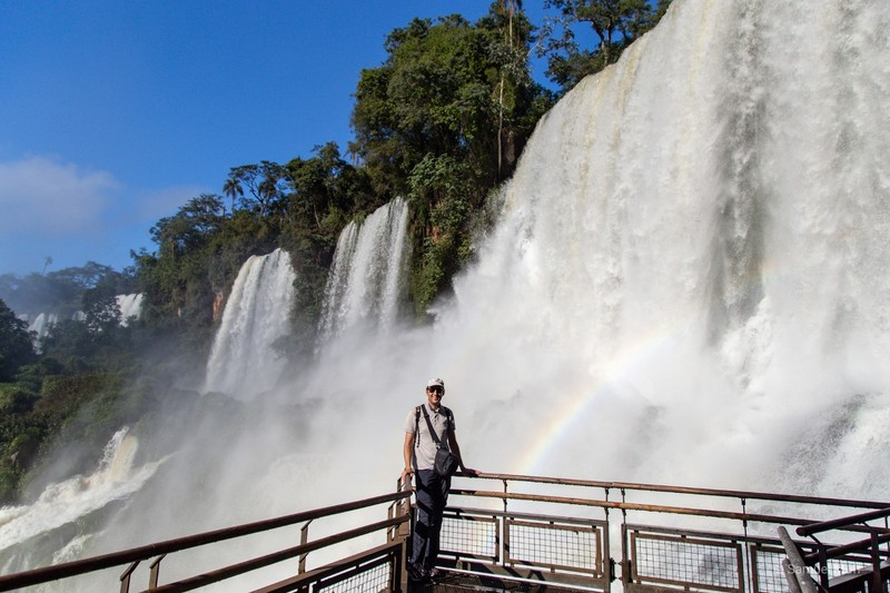 Sam close to a waterfall of the Iguazú Falls