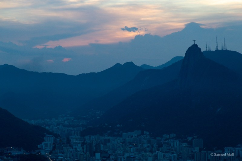 Christ the Redeemer standing over Rio at dusk, seen from Sugarloaf mountain