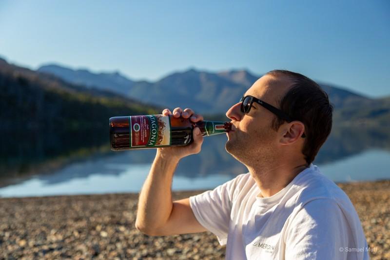 Sam drinking a Patagonia Amber Lager at Lago Futalaufquen in Parque Nacional Los Alerces