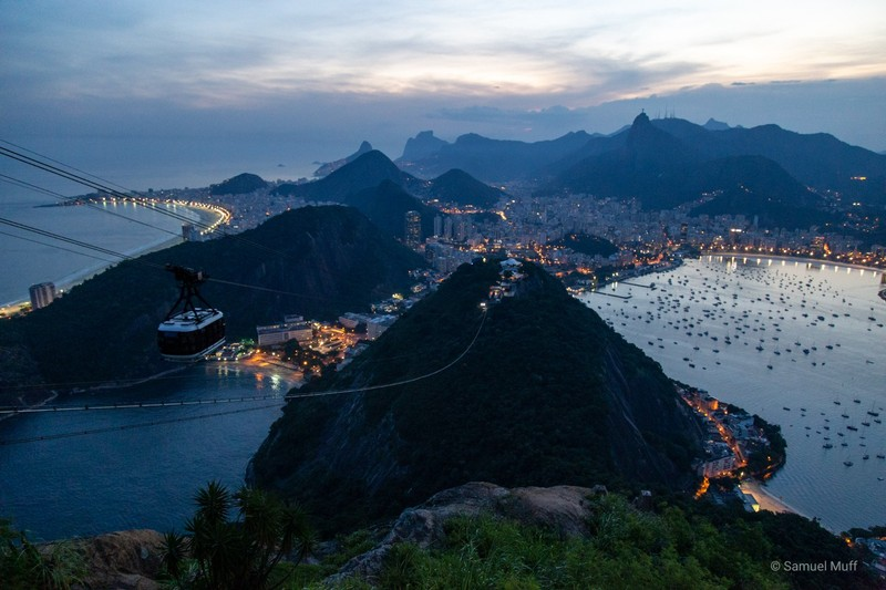 Rio de Janeiro at dusk with cable car in the foreground, seen from Sugarloaf mountain